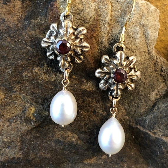 Historically inspired bronze and garnet earrings with freshwater pearl drop.