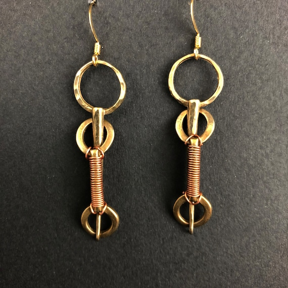 Hammered bronze interlaced spikes with copper wire