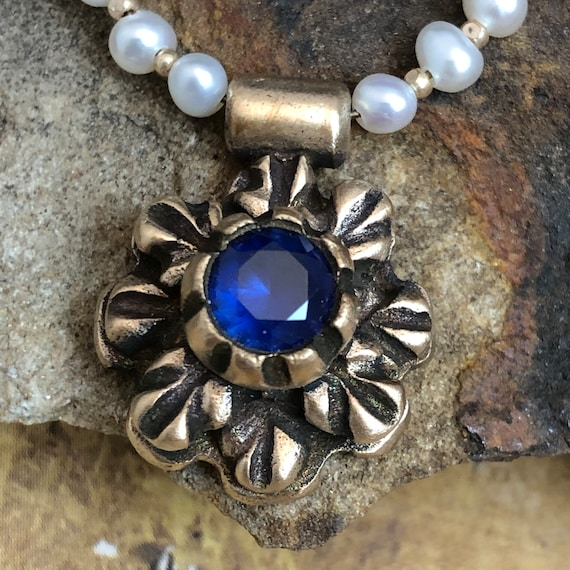 Historically Inspired bronze pendant necklace with Sapphire. 18 inches in length