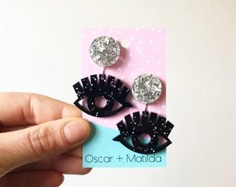 Statement Earrings Third Eye Evil Eye Black Acrylic Earrings Holographic Glitter Laser Cut Dangles with Chunky Silver Studs Oscar & Matilda