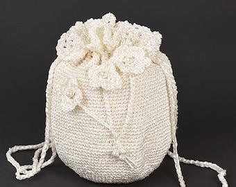 Milky white silk crochet handbag with flowers and perls h 20cm d 15cm