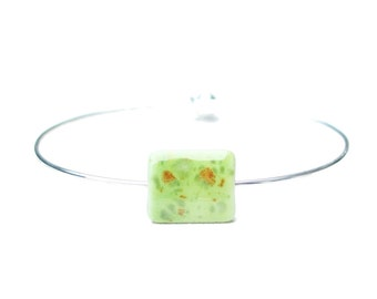 Silver and porcelain bracelet. Pistachio green porcelain bead silver plated bracelet. Semirigid, elliptic. Italian jewelry. Gift ideas.