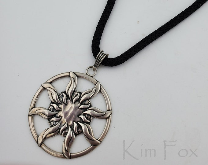 KFP333 Larger Sundance Pendant in silver or golden bronze - round 1 7/8 inch two sided pendant with large bail in silver by Kim Fox