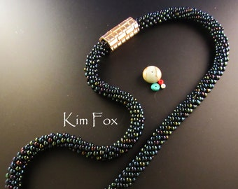 Beaded Kumihimo Necklace of irridescent blue with 6 sided brick patterned magnetic clasp with security pin - made by Kim Fox