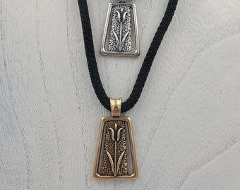 KFP347 Tulip Pendant symbol of spring and rebirth with large bail in Golden Bronze and  Silver designed by Kim Fox 1 3/4 by one inch in size
