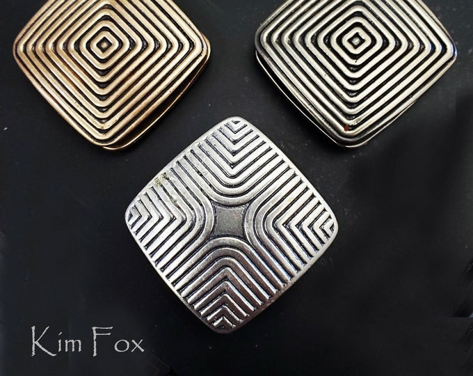 In the Groove two sided two shaped magnetic clasp in silver, golden and white bronze designed by Kim Fox