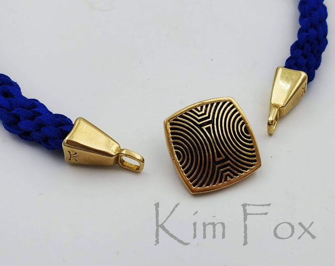 KF372 A Pair of Rounded Rectangle cones with loop designed white and golden bronze by Kim Fox perfect for cord, leather, kumihimo.