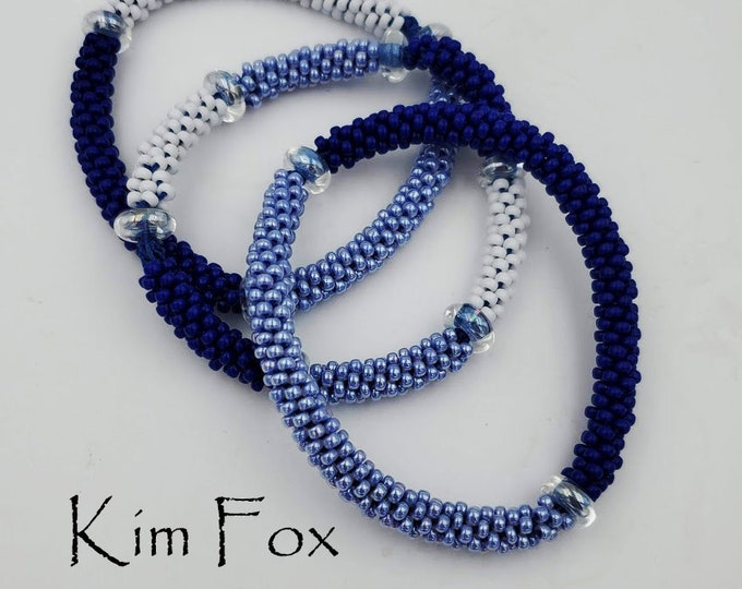 Three patterns for multisection seamless bangles made with kumihimo kongo gumi designed by Kim Fox