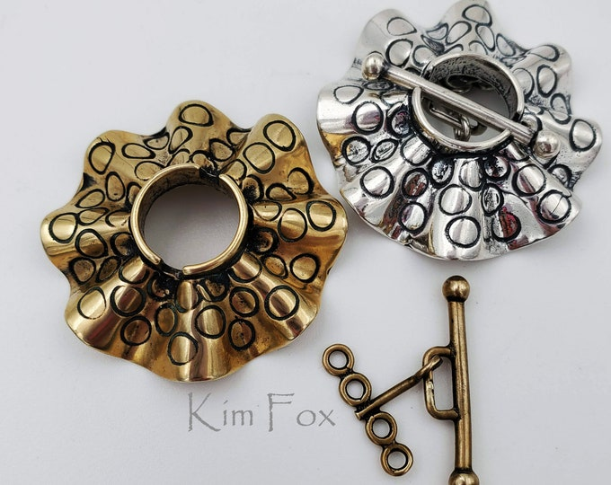 C 186 Larger Round Silver or Bronze Secure Toggle with 4 loops in Silver with Sea Urchin Pattern by Kim Fox