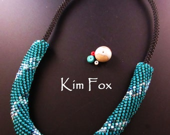 Teal Spiral - Peyote with a twist Slide on a black necklace. Designed and Made by Kim Fox Purchased clasp