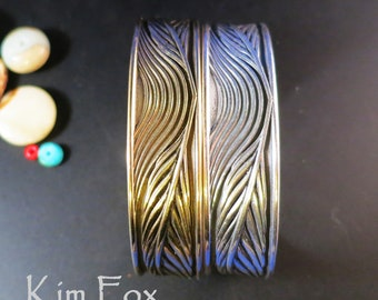 Phoenix feather to flight cuff designed by Kim Fox in silver and golden bronze