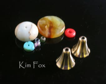 A Pair of Small Bell Flower Cones in Golden Bronze 14mm by 10mm opening designed by Kim Fox