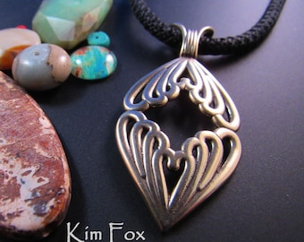 KFB48 Double Heart Pendant iin golden bronze designed by Kim Fox - An unusual way to show that 2 hearts can be as one