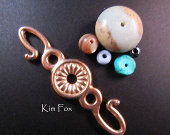 Rosette Hook for connecting cords, chain, chain mail. Two sided in bronze and sterling silver designed by Kim Fox