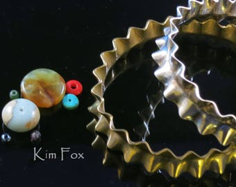KFP26 8 inch Wide Ruffle Bangle in Golden Bronze 15 mm wide or 9/16 inch made to wear alone or with others. Oval in shape and comfortable