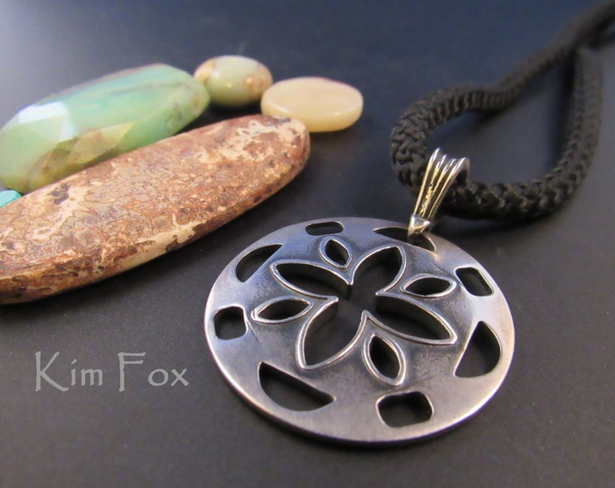 Cut Flower Pendant 1 1/2 by 2 inches in sterling silver or golden bronze -two sided - designed by Kim Fox - wear it with other necklaces