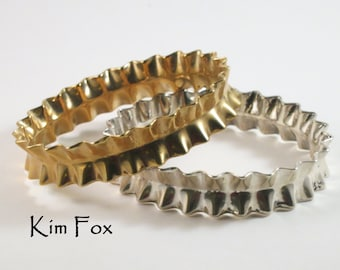 KFB34 9 inch Ruffle Bangle in Golden Bronze or Sterling Silver made to wear alone or with others. Oval in shape for comfort.