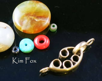 Pod Shaped Slot Clasp suitable for necklace or bracelet in golden bronze by Kim Fox