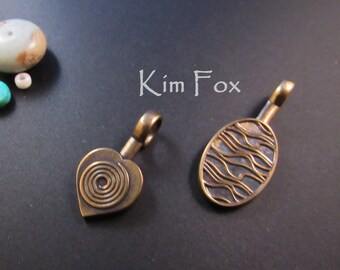 Heart or Oval Glue On Bail in golden bronze for cabs, glass, stone, polymer and metal designed by Kim Fox