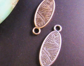 Solid Oval Swirl- use for earrings, clasps, links, stations in Sterling Silver or Golden Bronze by Kim Fox