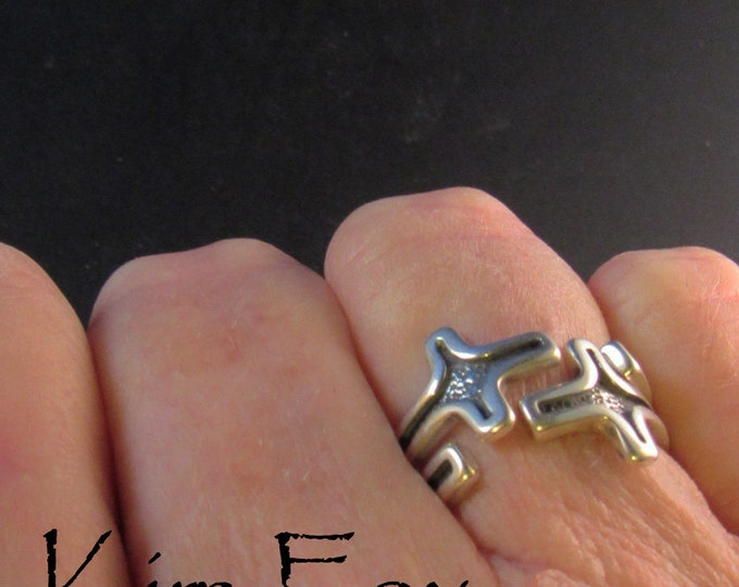 Interlocked Stackable Pair of Cross Rings - adjustable - can be worn singly or in pair in silver designed by Kim Fox