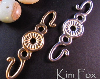 KF368 Rosette Hook for connecting cords, chain, chain mail. Two sided in bronze and sterling silver designed by Kim Fox