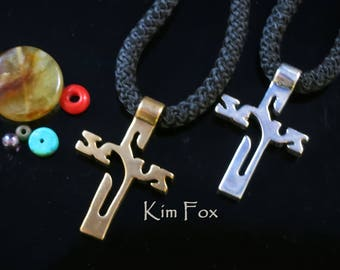 KFP171 Jesus Cross in Bronze and Silver The design is based on one from Central America is has a surprise when you look at it.