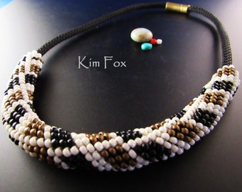 Peyote with a Twist Slide on a  black cord with a magnetic clasp made by Kim Fox
