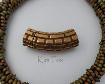 Curved Magnetic Clasp with Brick Pattern in bronze and white bronze designed by Kim Fox