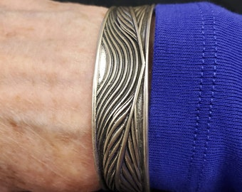 KFB403 Phoenix feather to flight cuff designed by Kim Fox in silver and golden bronze