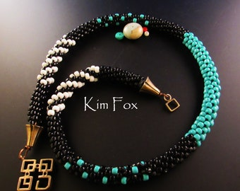 Turquoise, Black and White multipatterned kumihimo necklace with clasp and cones designed by Kim Fox  20 inches long