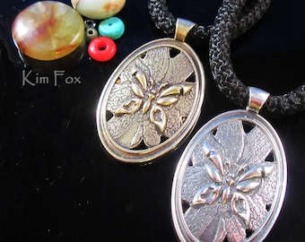 KFP361 Oval Butterfly Pendant of Butterfly on a Wild Rose - Symbol of Transformation - In bronze and sterling silver