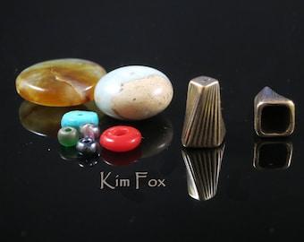 KF306 A Pair of Small Deco Twist Cones in Silver or Bronze designed by Kim Fox