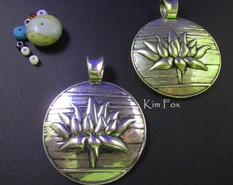 Lotus Pendant in Silver and Bronze designed by Kim Fox 2 inches by 1 1/2 inches or 50 by 41 mm. Textural and dimensional with large bail.