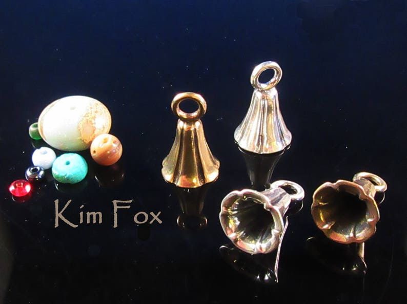 KF343RB  A Pair of Bell Shaped Glue In Cones with large loop iin RED BRONZE designed by Kim Fox