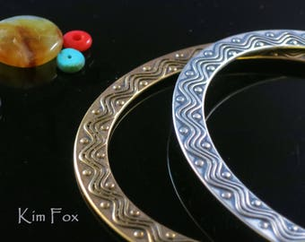 KFB27 7 inch Oval Two Sided Wave and Dot Bangle in Golden Bronze by Kim Fox made for the petite hand