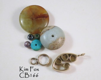 C166 Pod Shaped Slot Clasp in golden bronze and sterling silver by Kim Fox