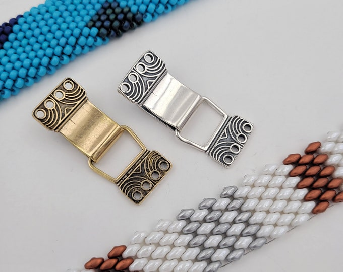 KF462 in silver and golden bronze designed by Kim Fox - a secure slide clasp suitable for a bracelet