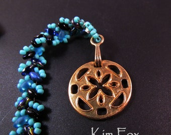 KF243 Smaller Cut Flower Element that can be used as a pendant, clasp, or component in silver and bronze designed by Kim Fox