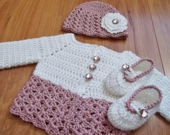 Button Me Up Baby Set Crochet Patterns.  Make a matching set for baby today.   Slippers, cardigan, hat, and flower patterns included in set.