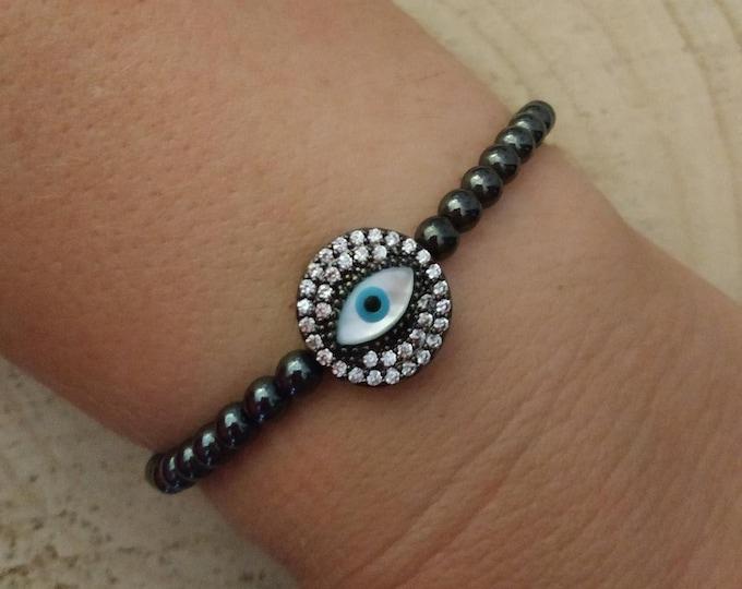 Evil eye paved round charm with hematite beads