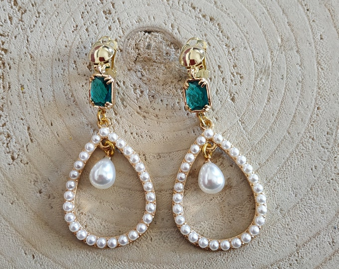 Long emerald crystal clip on earrings with pearls.