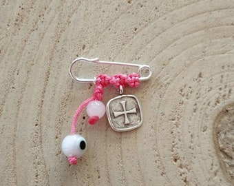 Modern keepsake token for newborn baby girl with silver charmss.