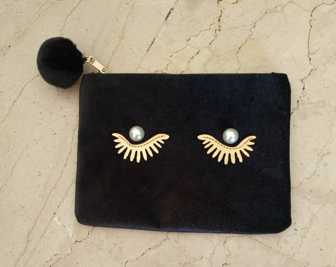 Black velvet purse with eyes and lashes with pearls