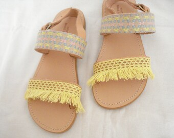 Greek leather flat sandals decorated with yellow fringes