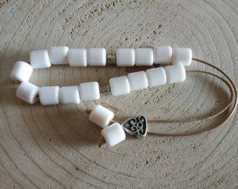 21 white worry beads, Greek tradition komboloi