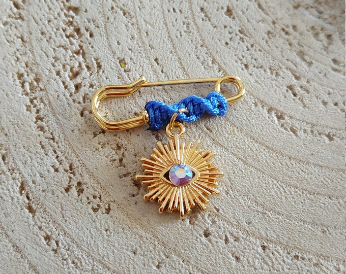 Sparkling evil eye with spikes blue brooch