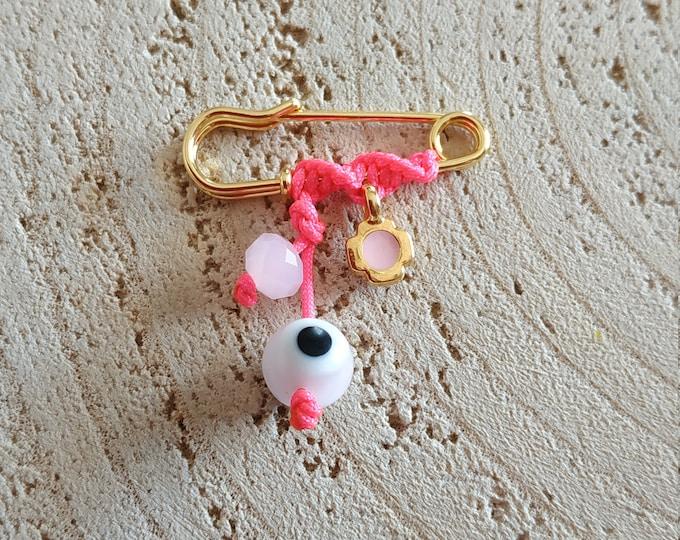 Mini pink cross brooch for baby girls.