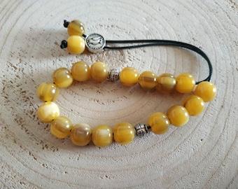 Yellow resin worry beads