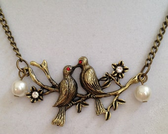 Love Birds and Pearl Necklace